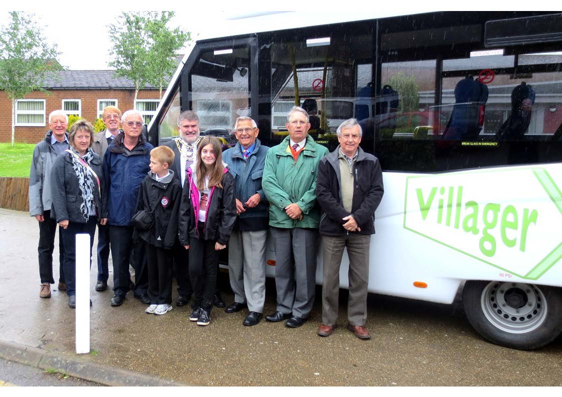 Some of the drivers and passengers of the Villager Minibus